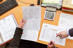 accountants filling out tax forms